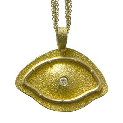 Golden eye pendant