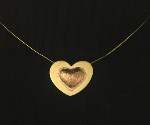 Brassy heart pendant on neck-Natalie Barat Design