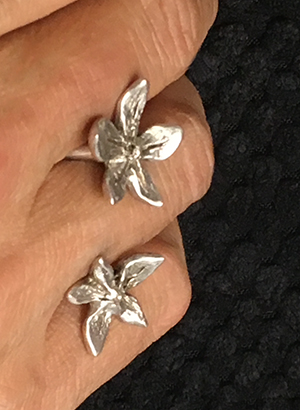 Fllower power between the finger ring- Natalie Barat signature design and best seller