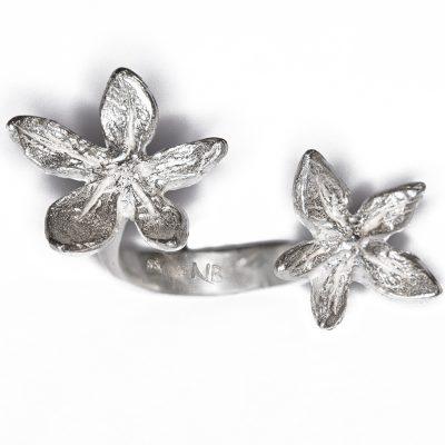 Fllower power between the finger ring- Natalie Barat signature design and best seller