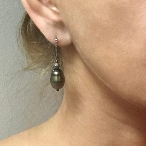 Tahitian-Pearl-diamond earrings-on ear-Natalie Barat Design