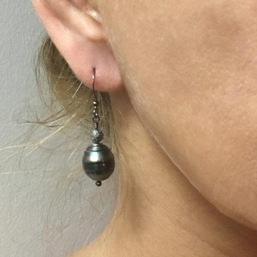 Tahitian-Pearl-diamond earrings-on ear
