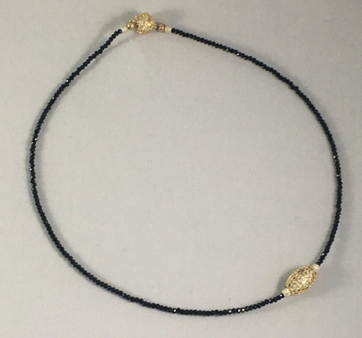 black Spinel and micro pave gold tone with magnetic clasp
