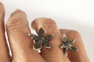 Oxidized flower power between the finger ring- Natalie Barat signature design and best seller