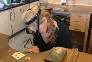 Natalie Barat Sawing a heart piece for handmade design