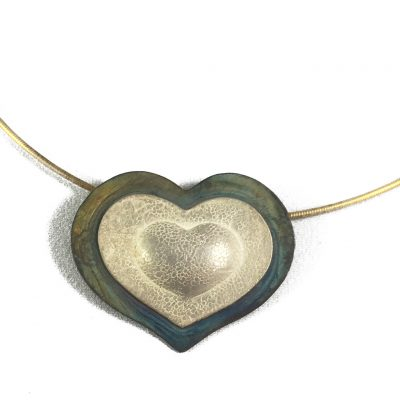 Silver and copper heart neck;lace