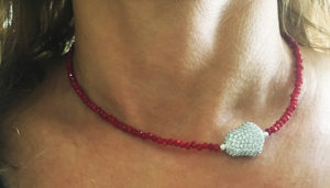 Crimson crystal necklace with magic bean