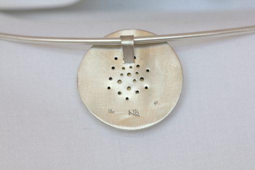 back of eruption necklace