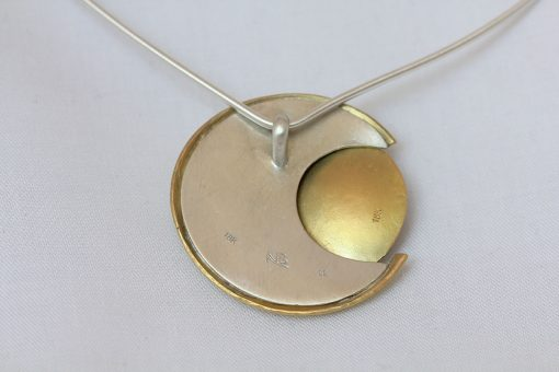 back of solar eclipse necklace