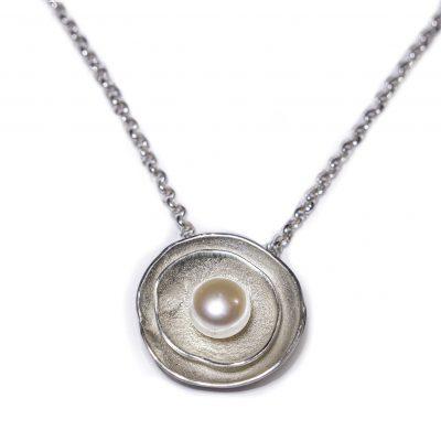 birds nest pearl pendant