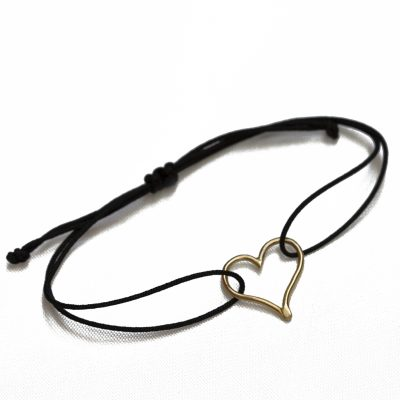gold mini heart on black cord