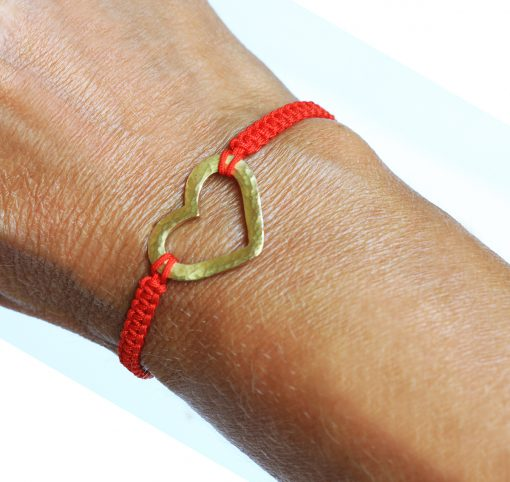 18K gold hammered heart bracelet on wrist