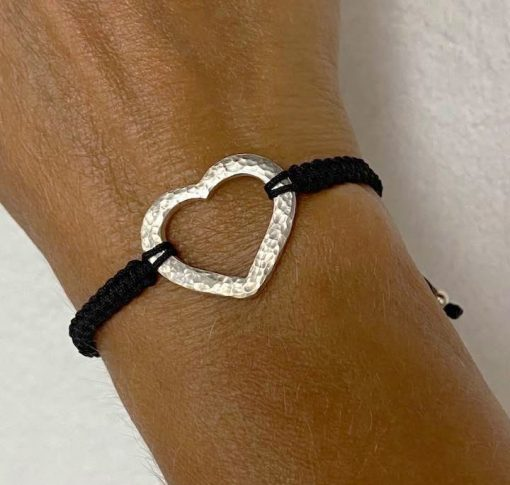 Silver hammered heart bracelet on wrist