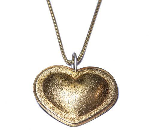 Brassy heart pendant on neck-Natalie Barat Design