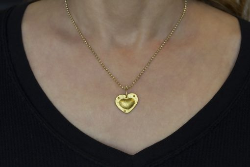 riveted gold heart on neck